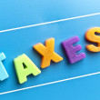 Taxes word on blue board — Stock Photo #8015546