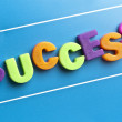 Success word on blue board — Stock Photo #8015561