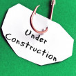 Under Construction message on paper — Stock Photo