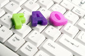 Faq word made by colorful letters on keyboard — Stock Photo