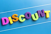 Discount word on blue board — Stock Photo