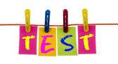 Test word on laundry hook — Stock Photo