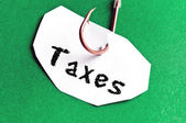 Taxes message on paper — Stock Photo