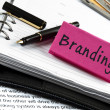 Branding note on agenda and pen — Foto de Stock