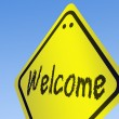 Welcome word on road sign — Stockfoto