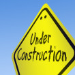 Under construction word on road sign — Stock Photo #8218187