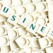 Business word made by leter pieces - Stock Photo