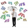 Discount word and business man with umbrella — Stock Photo #8218658