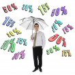 Discount word and business man with umbrella — Stock Photo