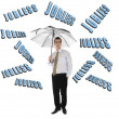 Stock Photo: Jobless word and business mwith umbrella