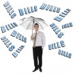 Stock Photo: Bills word and business man with umbrella