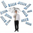 Bills word and business man with umbrella — Stock Photo