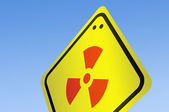 Nuke icon on road sign — Stock Photo
