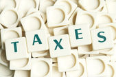 Taxes word made by leter pieces — Stock Photo