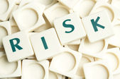 Risk word made by leter pieces — Stock Photo