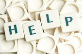 Help word made by leter pieces — Stock Photo