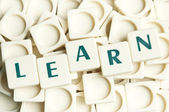 Learn word made by leter pieces — Stock Photo