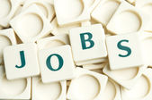 Jobs word made by leter pieces — Stock Photo