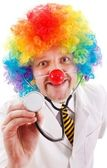 Funny clown doctor with stethoscope — Stock Photo