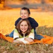 Kids playing outdoors in autumn — Stock Photo #8002777