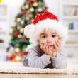 Cute boy in front of Christmas tree — Stock Photo #8002808