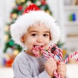 Boy eating twisted candy — Stockfoto
