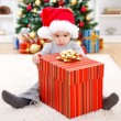Little boy sitting behind big present — Stock Photo #8003311