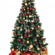 Green decorated Christmas tree and presents — Stock Photo