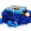 Blue Christmas gift surrounded with blue garland — Stock Photo