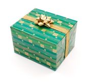 Green gift with golden bow — Stok fotoğraf