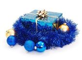 Blue Christmas gift surrounded with blue garland — Stok fotoğraf