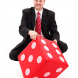 Businessman with dice — Stock Photo