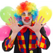 Happy clown with balloons, gesturing with hand — Stock Photo