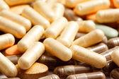 Medicinal pills piled up a bunch — Stock Photo
