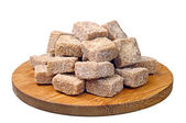 Cubes of brown cane sugar — Stock Photo