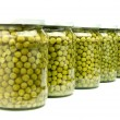 Five jars of preserved green peas — Stock Photo