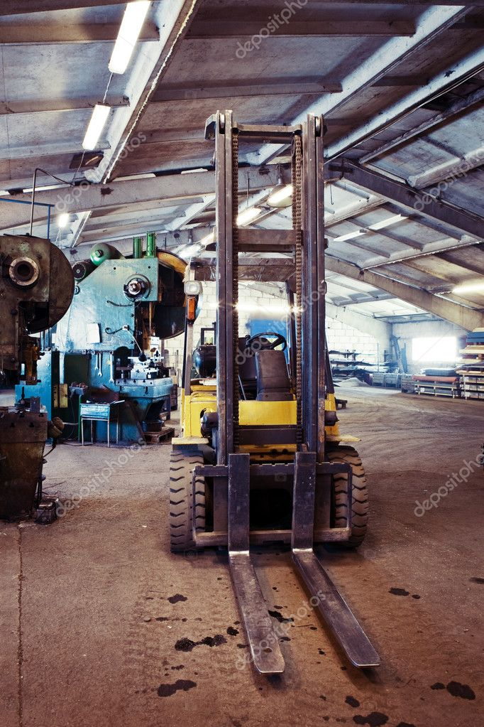 Fork lifter truck in the industrial interior of a small factory  Stock Photo #10303669