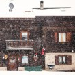 Snowing in front of tradition house — Stok fotoğraf