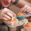 Delicious muffins with chef — Stock Photo
