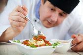 Male chef in restaurant — Stock Photo