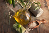 Natural spa setting with olive oil. — Stock Photo