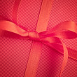 Royalty-Free Stock Photo: Red bow on present
