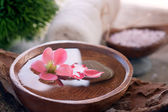 Spa setting with floral water — Stock Photo