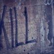 Kill Spray Lettering in a Grunge Wall — Stock Photo
