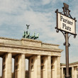 Pariser Platz Sign and Brandeburg Gate - Stock Photo