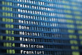 Flights information board in airport terminal — Stock Photo