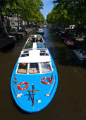 Tourist Cruise in Amsterdam Canal — Stock Photo