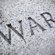 Stock Photo: War Lettering Carving