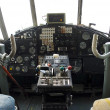 Stock Photo: Controls and equipment in cockpit of veteran airplane