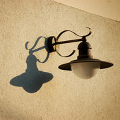 Retro street lamp with shadow — Stock Photo